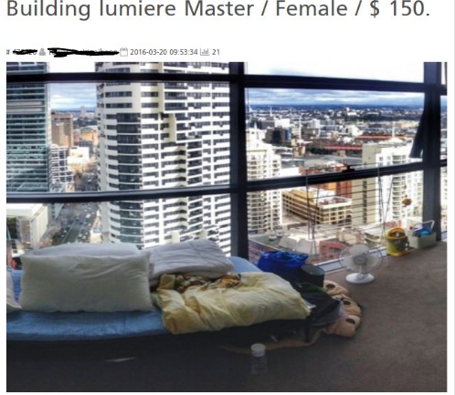 Bed in the living room of lumiere tower Sydney